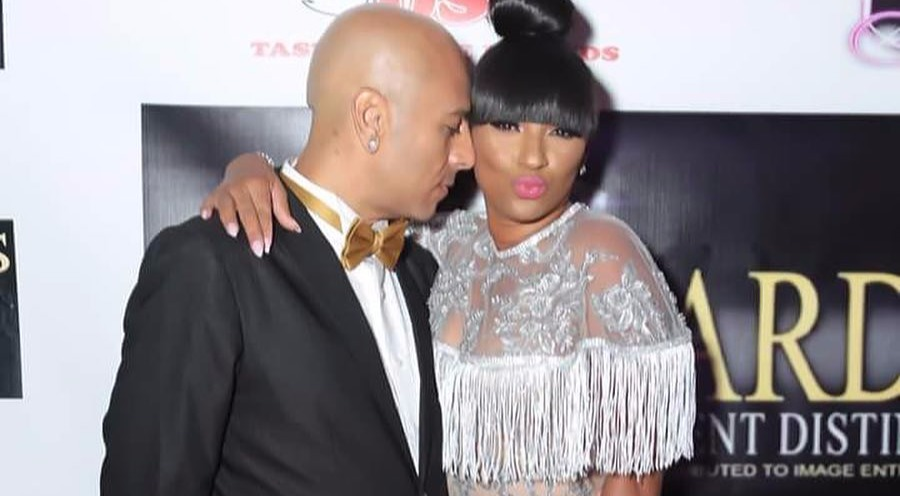 Tara Wallace and her ex-boyfriend Peter Gunz getting cozy in a red carpet event. The couple is looking hot, where Gunz is wearing a black suit and golden bow and Wallace is wearing a silver colored well-fitted dress.