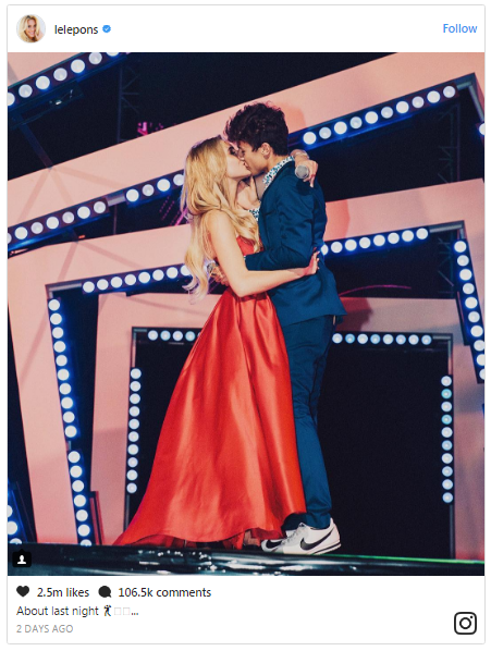Lele Pons and Juanpa Zurita kissing onstage. The were co-hosted MTV MiAw Awards Show.