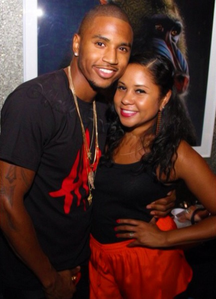 Angela Yee is cozying up to Trey Songz, who is holding her by the waist. Trey Songz is alleged to be Angela's ex-boyfriend.