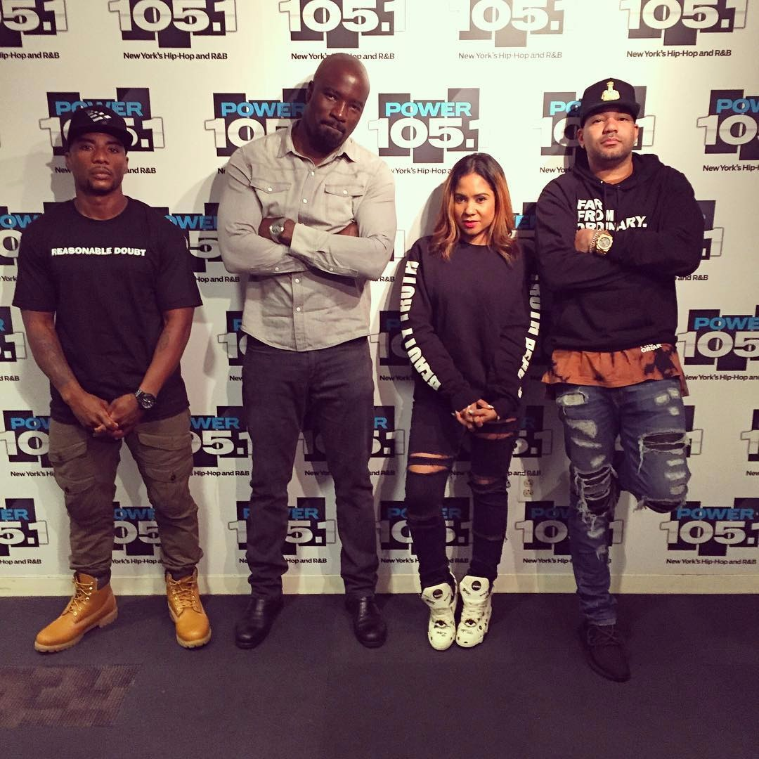 Angela Yee with The Breakfast Club co-hosts and Mike Colter