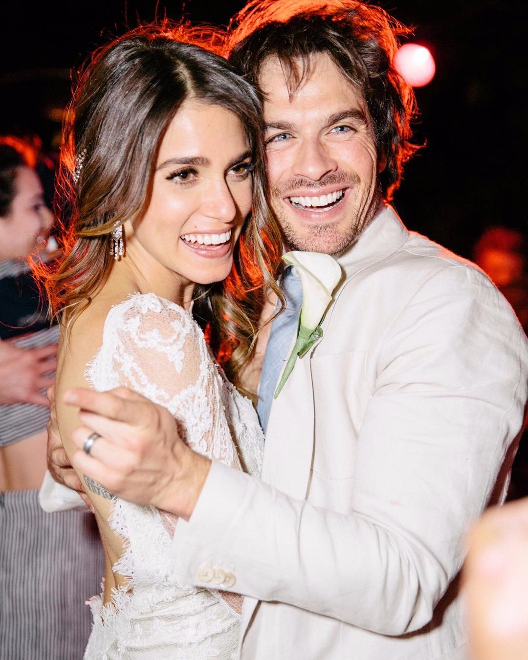 Ian Somerhalder and Nikki Reed embracing on their wedding day