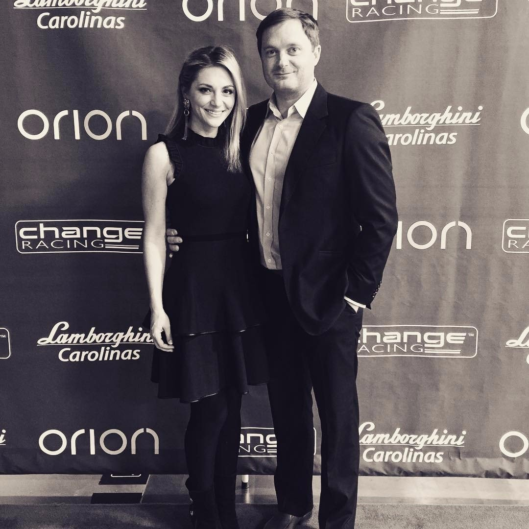 Robby and his fiance Danielle Trotta posing for a picture while attending a party for Change Racing and their sponsor Orion in December 2016.