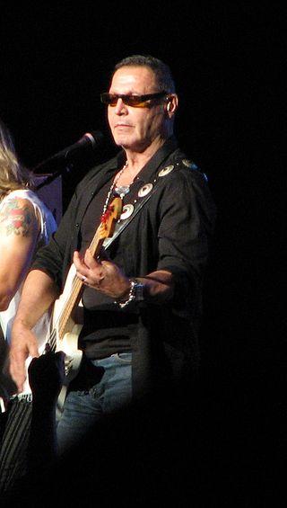 Chuck Panozzo playing guitar