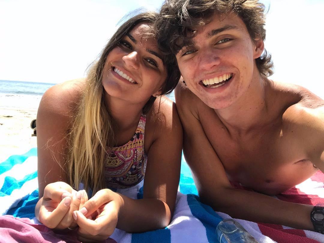 Makena Lautner on the beach next to boyfriend Jacob Moore
