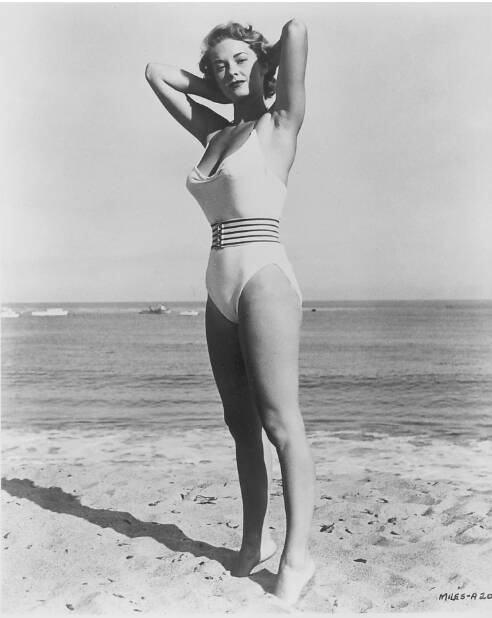 Vera Miles giving a pose at the beach in swim suit