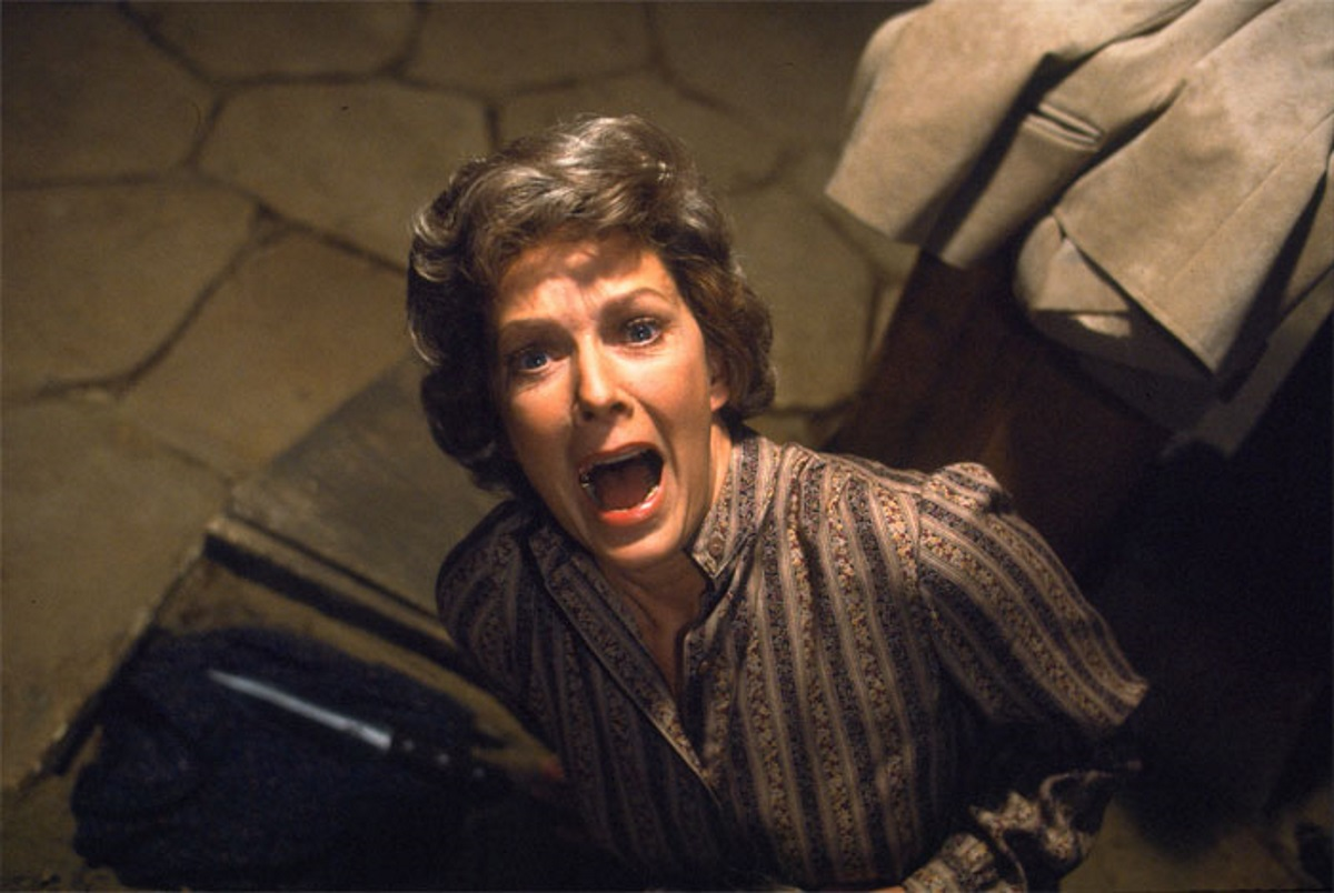 Vera Miles screaming in the scene of a movie Psycho II