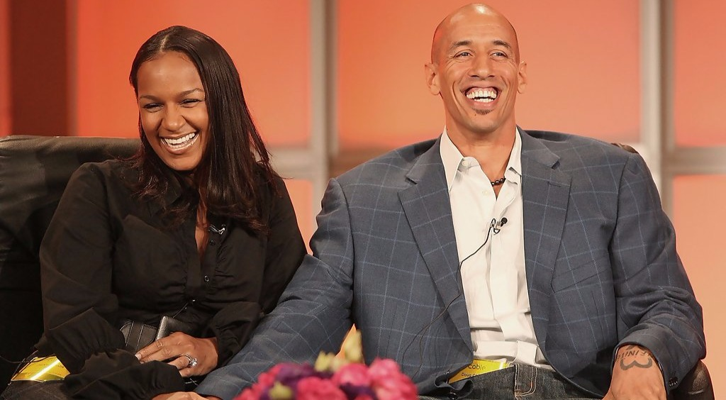 Jackie Christie and husband Doug Christie laughing out loud while speaking during Summer Television Critics Press Tour for BET Network in 2006.