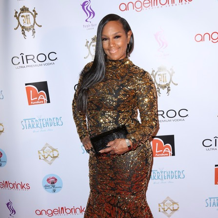 Jackie Christie posing for a picture while attending Angel Brinks Fashion 5th Anniversary in 2016