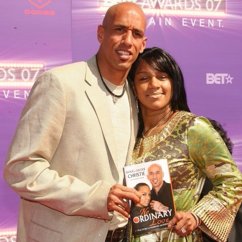 Jackie Christie and Doug Christie posing for a photo holding their book 'No Ordinary Love' at BET Awards 2007.