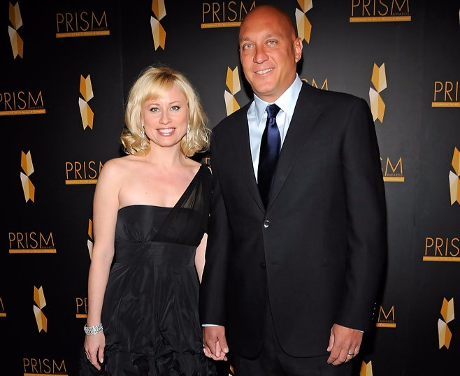 Steve Wilkos and wife Rachelle Wilkos clasping one another's hand while attending PRISM Awards 2010