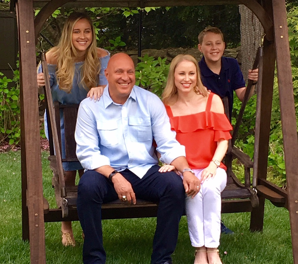 Steve Wilkos's family photo. Steve and wife Rachelle sitting and a daughter, Ruby & son Jack standing on back side.