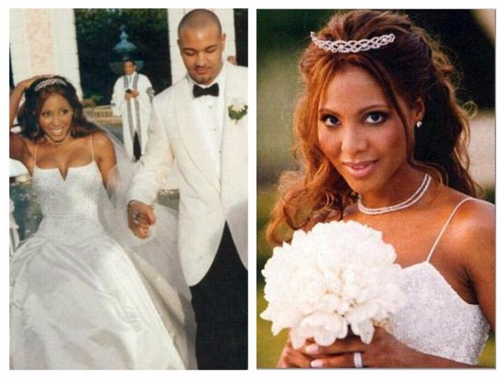 Keri Lewis and Toni Braxton on their wedding day. Keri is wearing a white tux and Toni is wearing a bridal gown.
