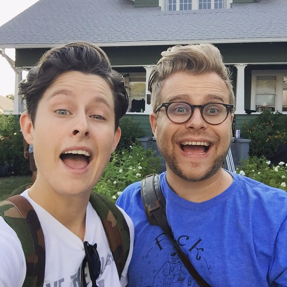 Adam Conover with his onscreen sister, Rhea Butcher