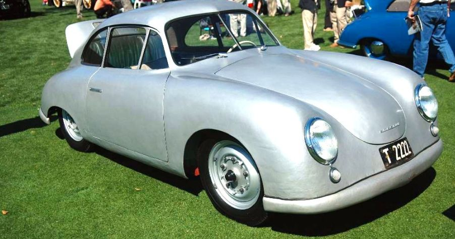 A picture of the 1949 Porsche 356. The exclusive vehicle has a beautiful silver body