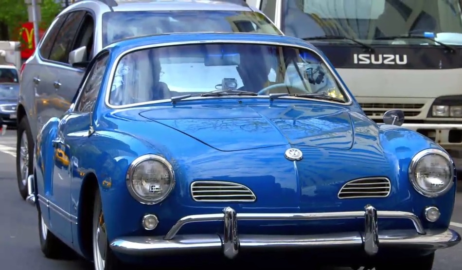 The car has a sleekly designed body that resembles the classic 'Beetle' shape.