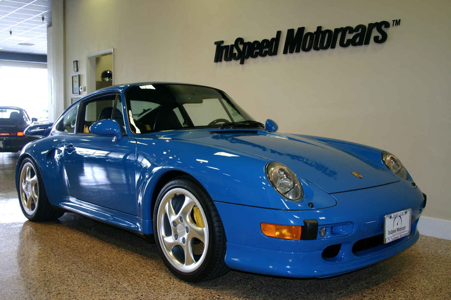 A blue Porsche 933 is another one of Jerry's beloved cars. The beautiful car has a small frame and large headlights