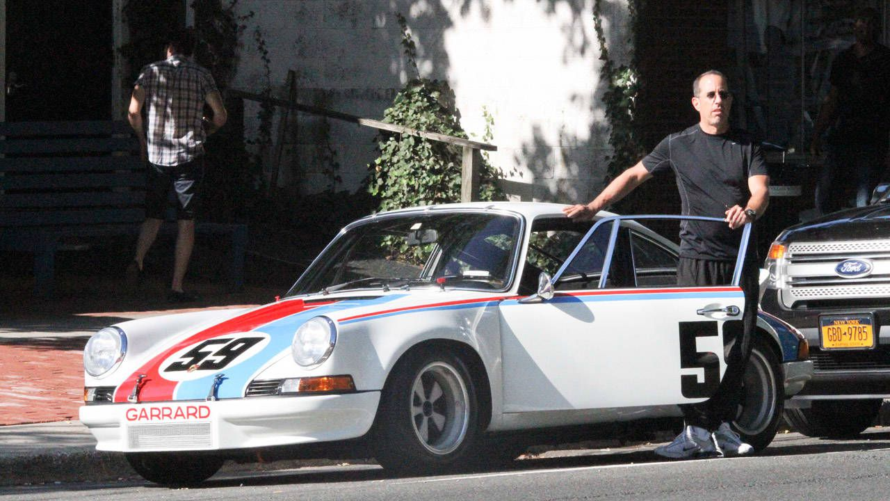 Jerry gets out of his Carrera in public. He is wearing casual clothes