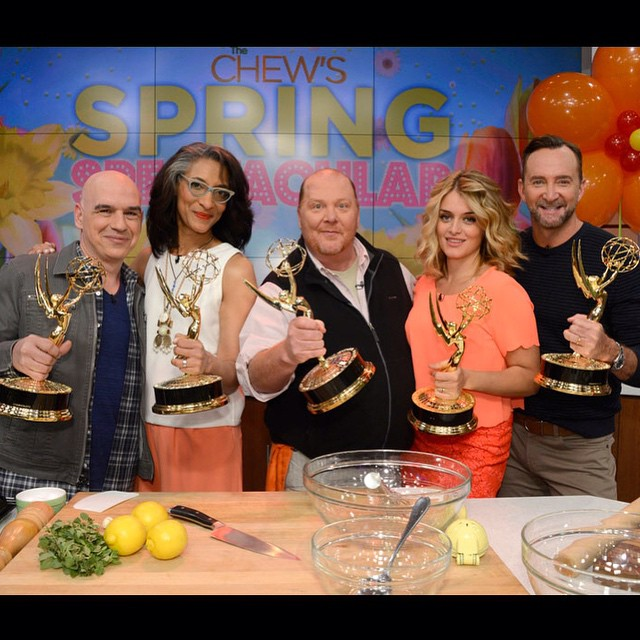 From left to right - Michael Symon, Carla Hall, Mario Batali, Daphne Oz, Clinton Kelly. They are on the set of The Chew, flaunting their Daytime Emmy Awards.