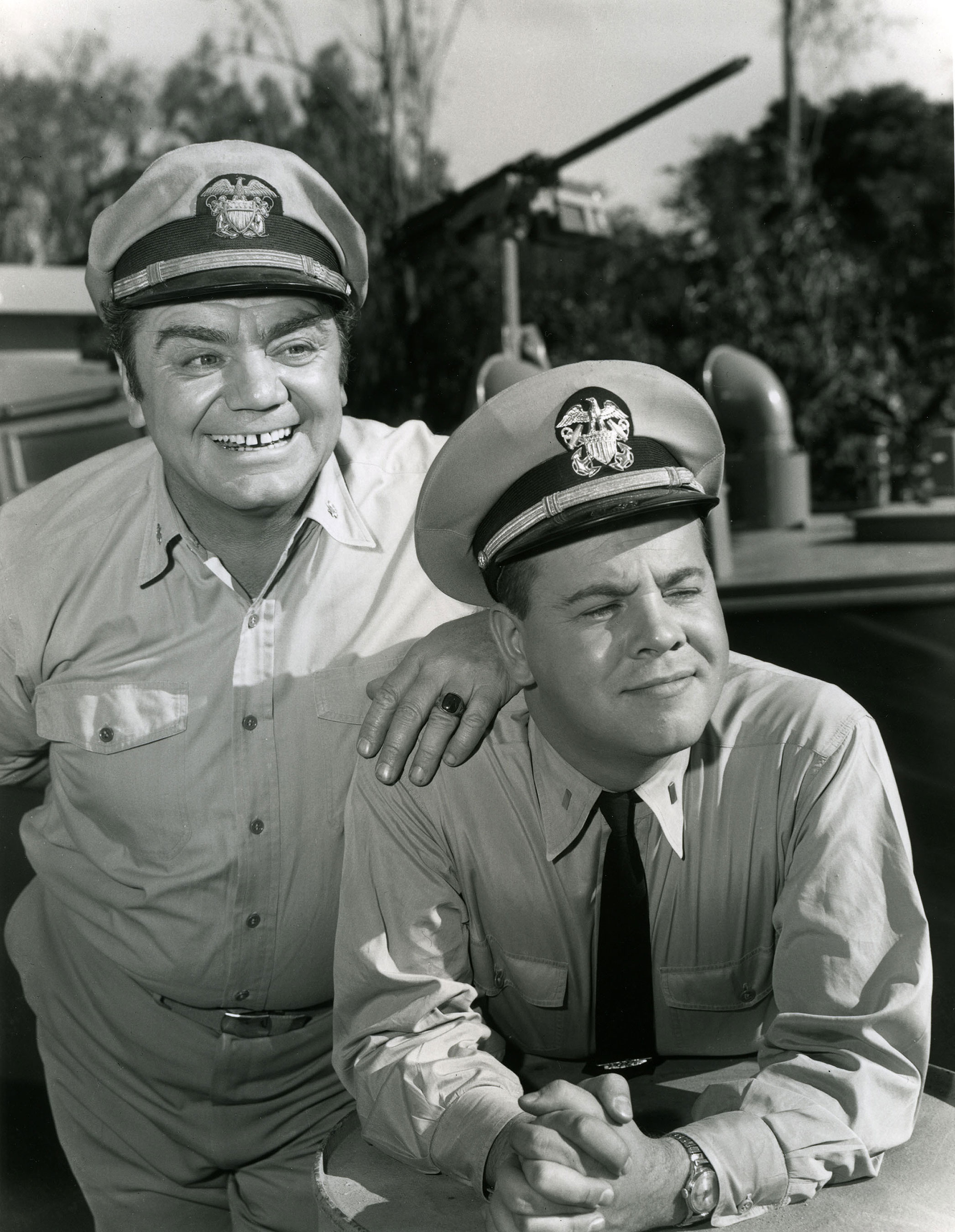 Tim Conway in his first film Mchale's Navy. The picture is B&W. He is with other star from the film.
