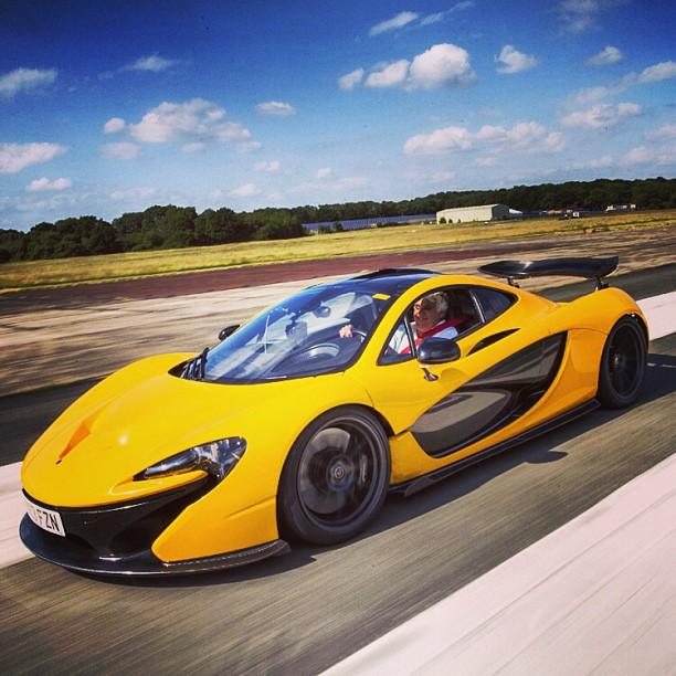 Jay Leno riding his yellow colored McLaren P1