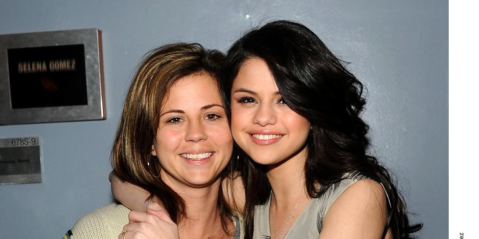 Selena Gomez is hugging her mother. They are smiling at the camera