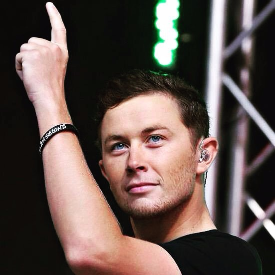 Scotty McCreery in one of his concerts. The photo takes his closure which distinctly shos his facial features.