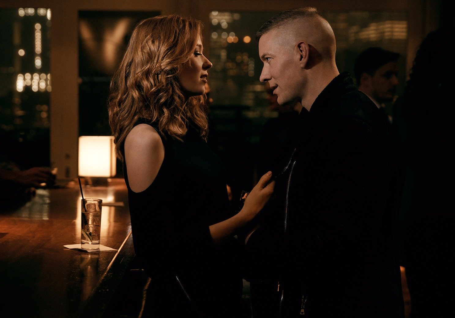 Joseph Sikora acting a scene with Lucy Walters at a bar.