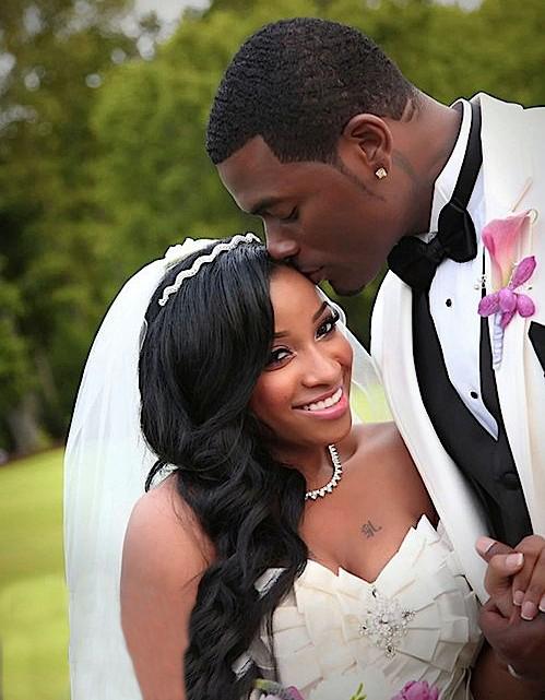 Mickey Wright kisses his new bride Antonia Wright