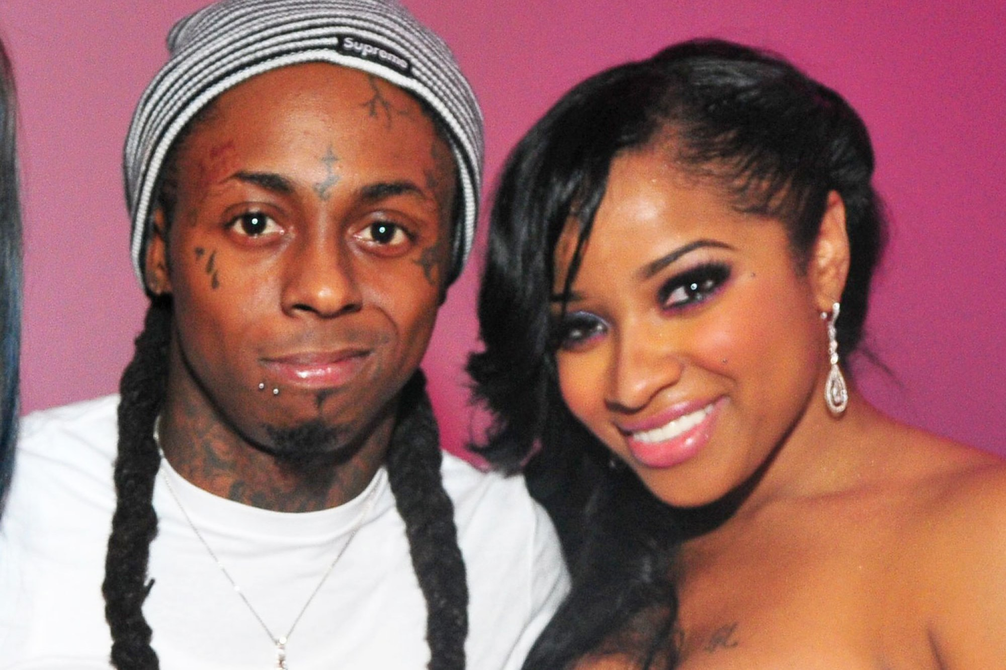 Toya Wright and ex-husband Lil Wayne takes a picture together.