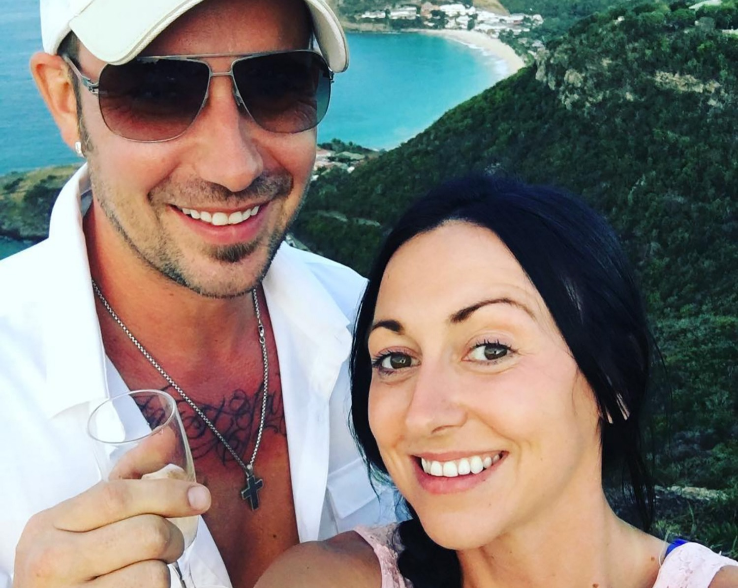 Jeremy Bieber is with his fiance Chelsea Rebelo. They both are smiling. Jeremy is holding a glass.
