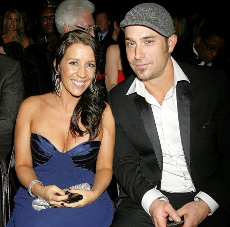 Jeremy Bieber is with his ex wife on a award show. Pattie is draining a royal blue ravishing attire and Jeremy is wearing a black coat and a grey cap. They both are looking in the camera with a smile.
