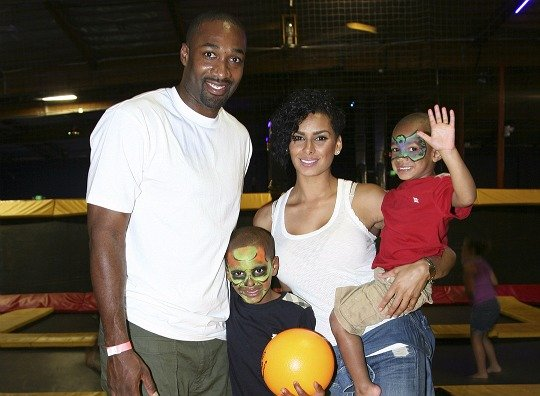 Happier times! Laura Govan and Gilbert Arenas posing with their two sons: Alijah and Aloni
