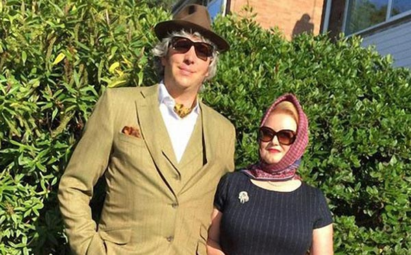 Edd China is having a snap with his beautiful wife Imogen China. They look perfect together. Both the pair are wearing shades. Edd is looking dashing in his light brown suit.