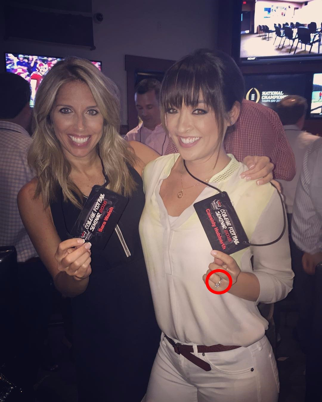Cassidy Hubbarth standing alongside Sara Walsh. A wedding ring on her left hand is visible.