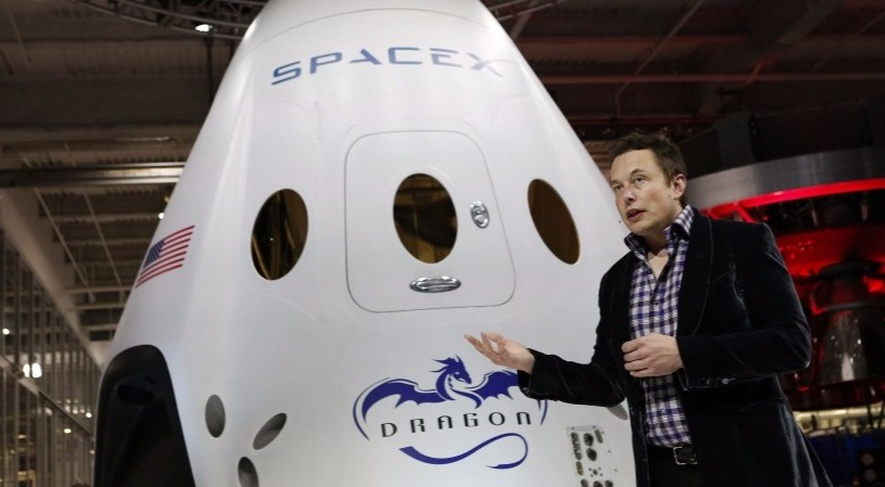 Elon Musk is explaining about his SpaceX's first spacecraft Dragon. He is the founder and CEO of the company.