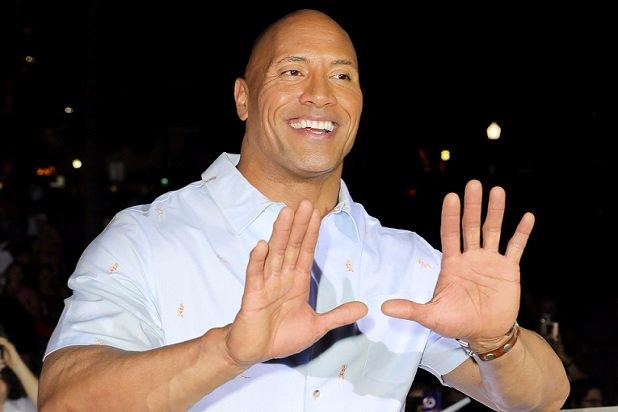 Dwayne 'The Rock' Johnson smiling with both his hands raised