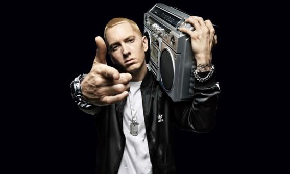 Eminem is holding a Radio Cassette Player on his shoulder