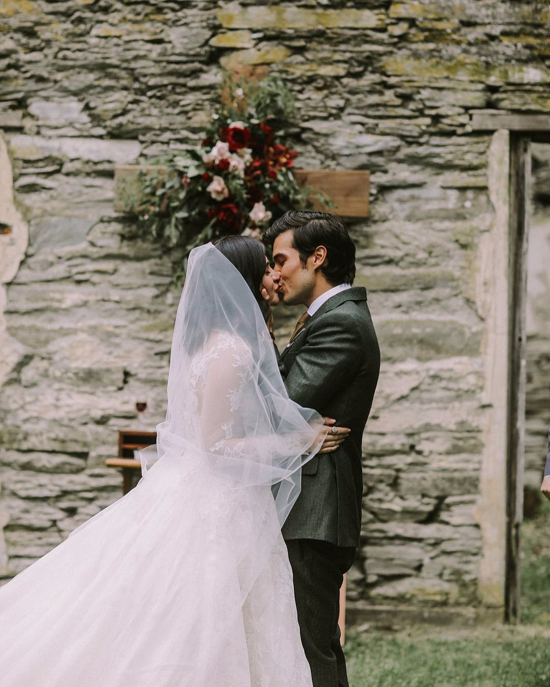 Erwan Heussaff kissing his new wife Anne Curtis on their wedding day