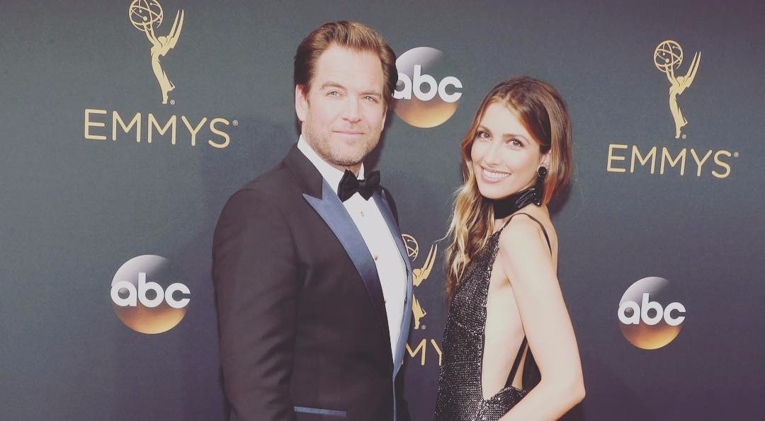 Michael Weatherly and his wife Bojana Janković pictured together at Emmys 2016. Michael is wearing black suit and Bojana is wearing backless black dress. Michael and Bojana are married since 2009.
