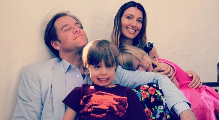 Michael Weatherly and his wife Bojana Janković smiling as their son Liam is making a funny face. Their daughter Olivia is leaning on Bojana's arm. Michael and Bojana are married since 2009.