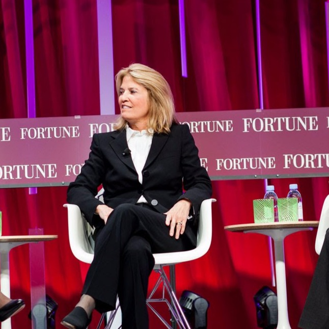 Greta Van Susteren sitting on a chair with her legs crossed