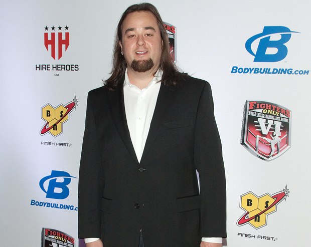 Chumlee attends an event in a white shirt and a black coat
