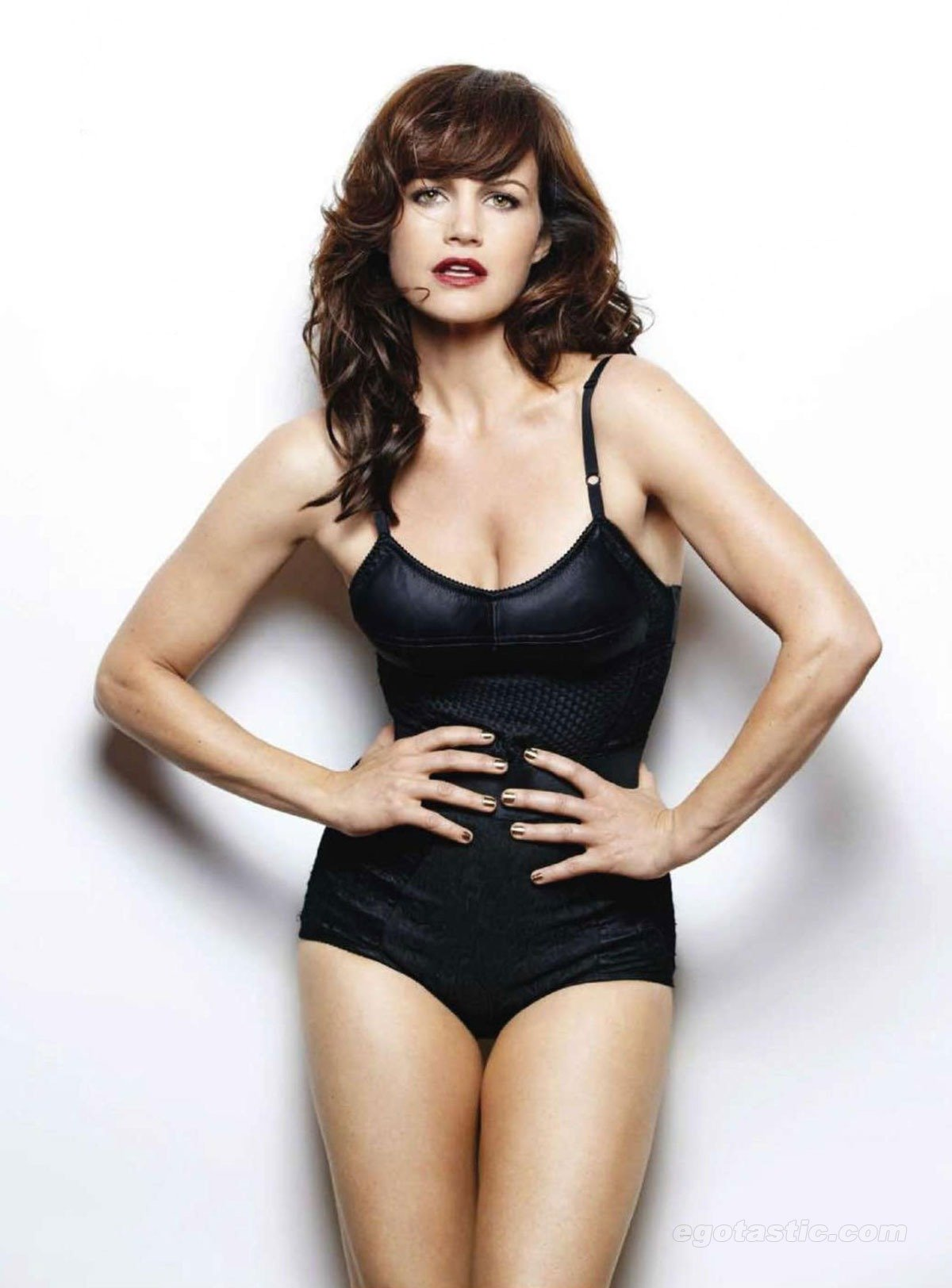 Carla Gugino looks steaming hot when she put on the sexy black lingerie. Her hot pics in bikinis are something that her fans are keenly interested in.