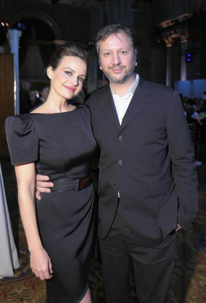 Carla Gugino and her longtime boyfriend Sebastian Gutierrez following a black dress code while attending an event