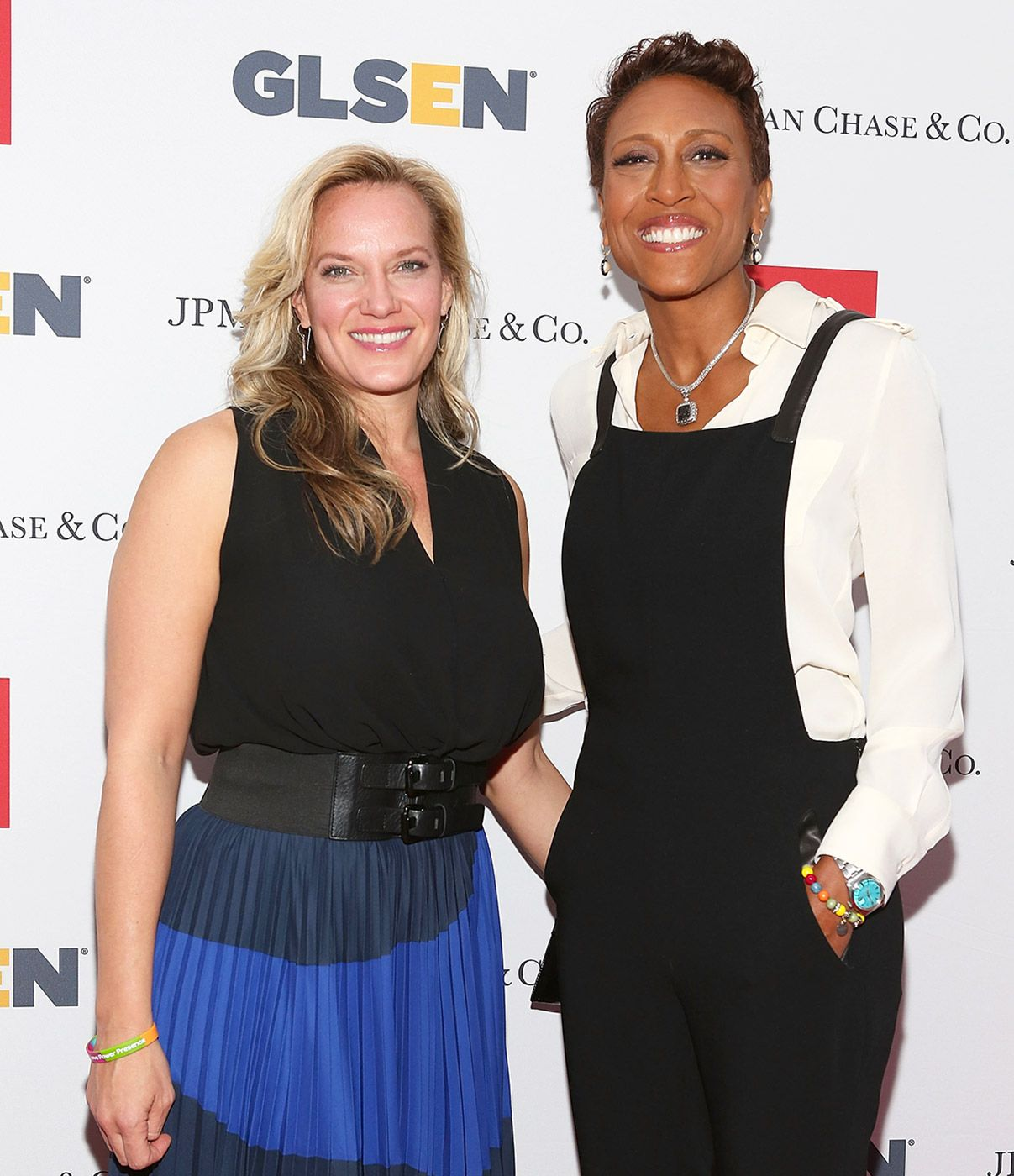 Robin Roberts sharing a smile with his partner, Amber Laign