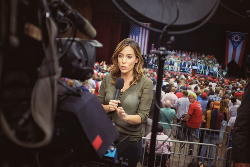 NBC's news correspondent Hailee Jackson standing infront of camera with a mic on her hand.