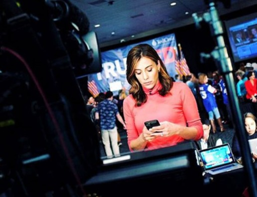 NBC's Hallie Jackson looking towards her mobile before her shot.
