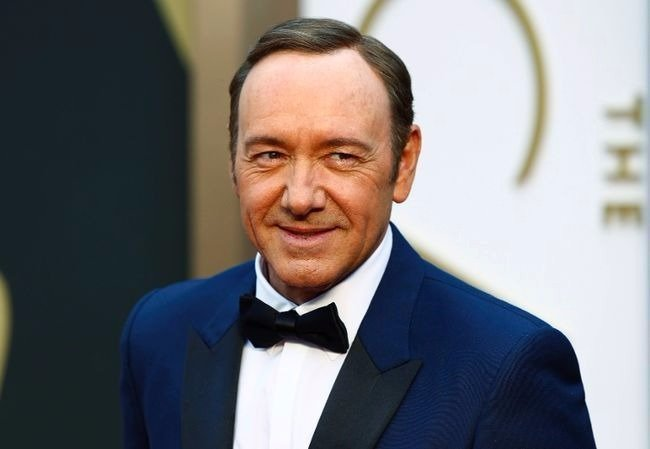 Oscar award winning actor Kevin Spacey  smiles as he looks away from the camera