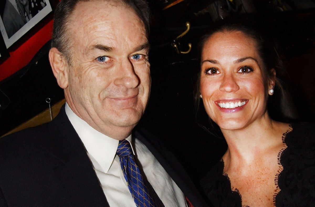 Bill O'Reilly and his ex-wife Maureen McPhilmy are standing close to each other as they take a photograph.