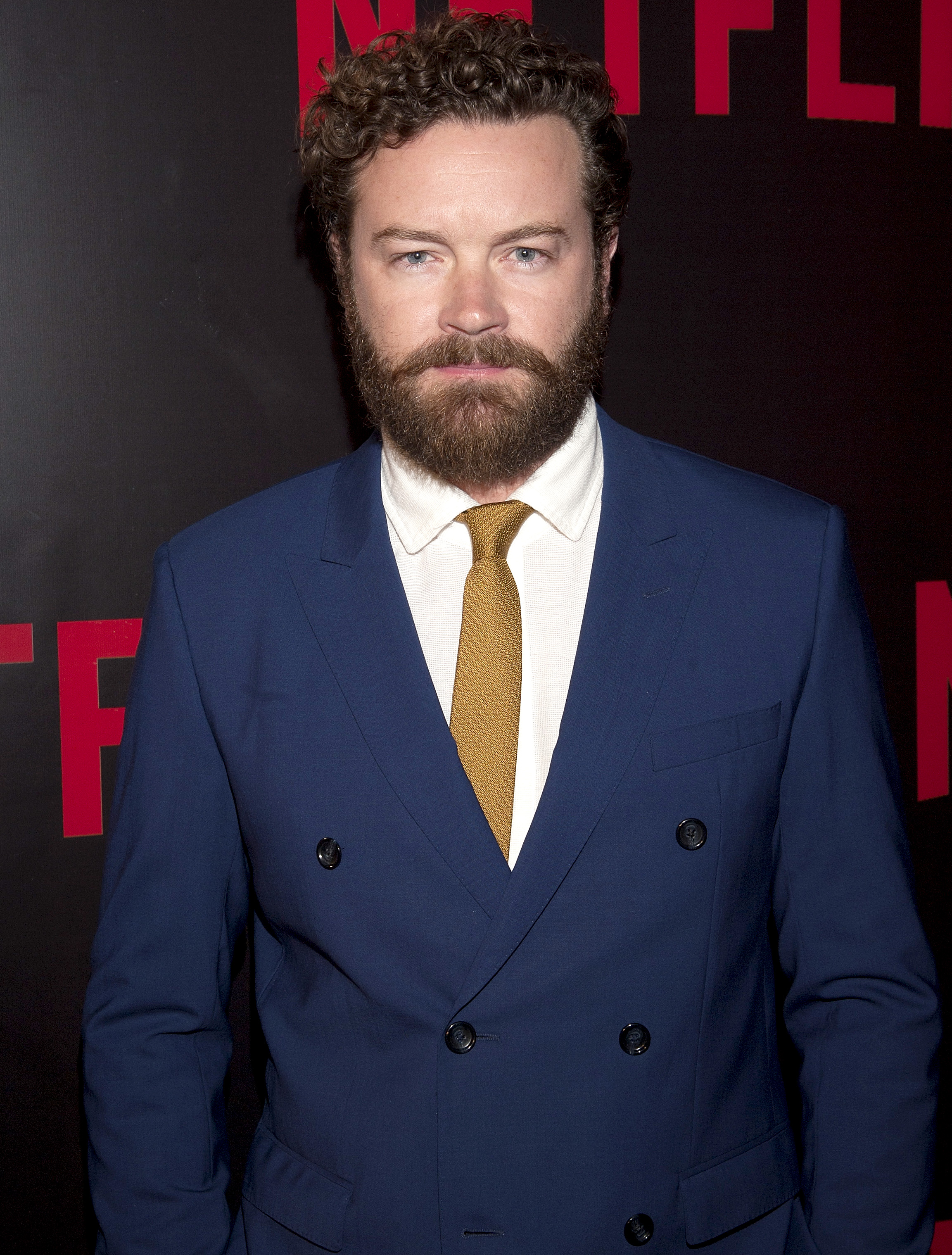 Danny Masterson wearing a blue suit.